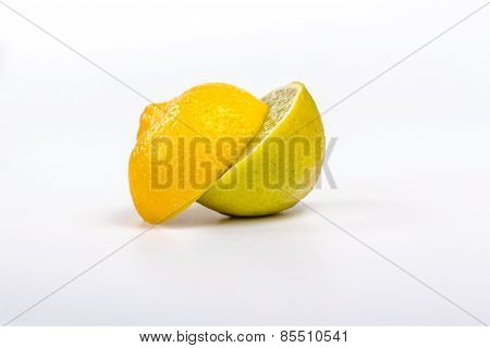 two half ripe lemon and lime. isolated on white background.