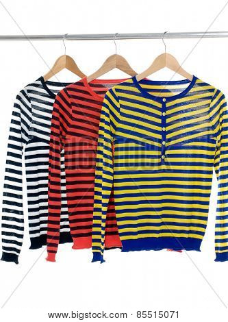 Row of female three clothing on hangers