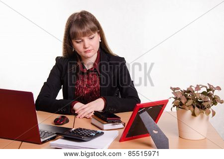 Detached Woman Sitting At Office Table