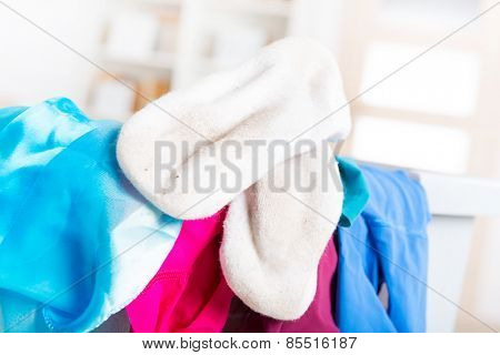 Dirty white socks on a hamper or basket