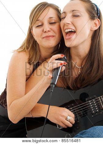 Girls Singing And Playing Guitar