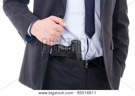 Gun In Policeman Or Bodyguard Pants Isolated On White