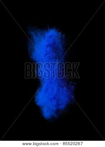 Blue powder explosion isolated on black