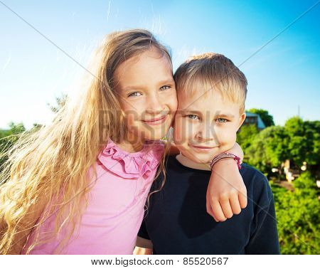 Happy smiling children at summer. Family outdoors