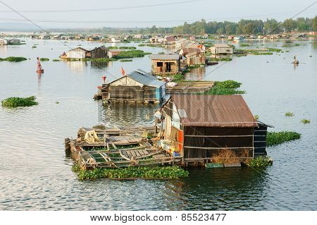 DONG NAI VIET NAM- FEB 28: Life of Asian fisherman on La Nga river group of floating house in residence of fishing village people make living by aquaculture river fish Vietnam Feb 28 2015