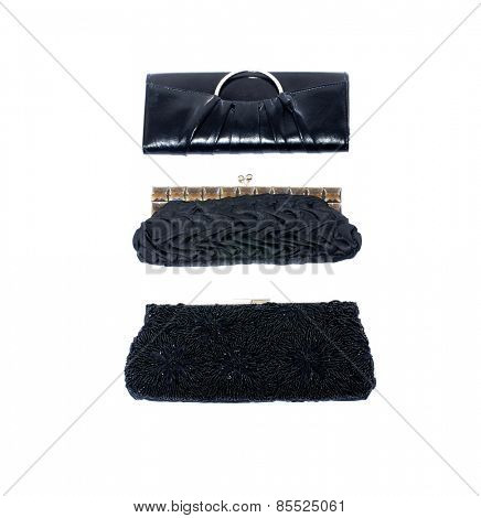 Three Glamour black purse isolated