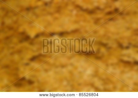 Intentional blurred background scene from a mountain of wood shavings and saw dust