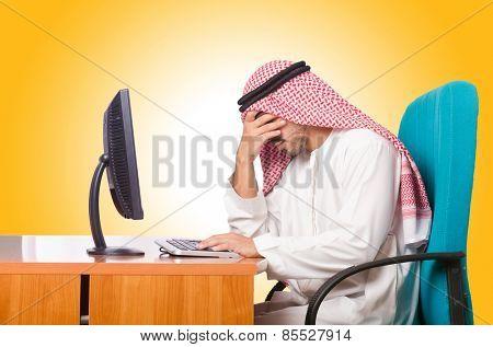Arab businessman working on computer
