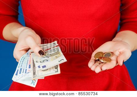 Euro And Coins In The Hands Of A Girl