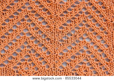 Openwork Pattern With Orange Thread On A Light Background