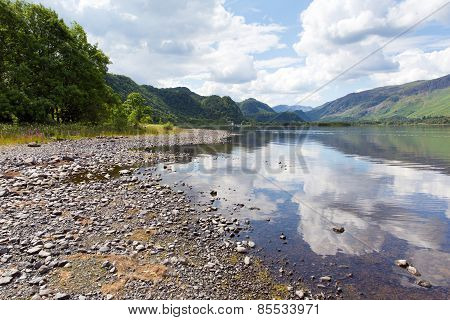 British Lake District in Cumbria UK at Derwent Water in summer on a calm day with white clouds