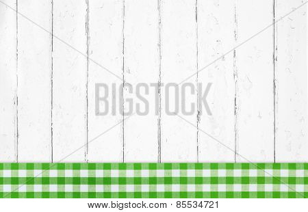 Old green white checked wooden background with fabrics.