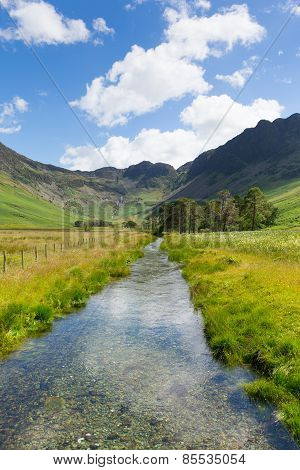 River in UK lake District and Haystacks mountain from Buttermere Cumbria
