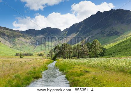 Beautiful Lake District river and Haystacks mountain from Buttermere UK Cumbria
