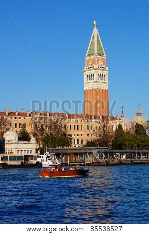VENICE, ITALY - DECEMBER 31, 2012: Water taxi against St. Mark's Campanile. Water taxi is the best way to make city tour in Venice