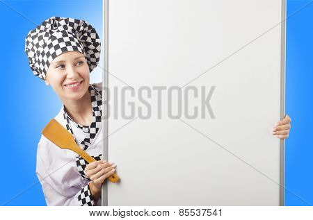 Cook with ladle and blank board