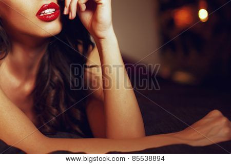 Sexy Woman With Red Lips On Bed Closeup