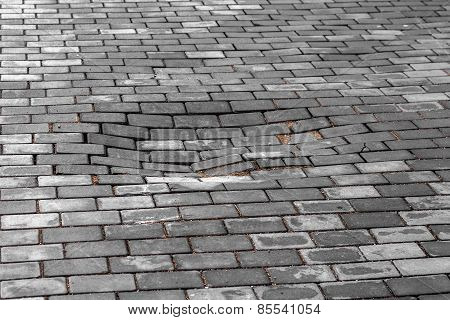 Paving Decorative Tiles. Poor Road. In The Middle Of The Sidewalk Collapsed Pavement And Formed A Pi