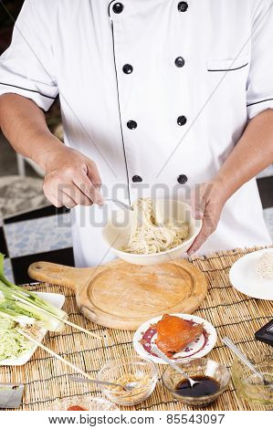 Chef Holding The Noodle From The Bowl With Fork