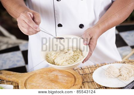 Chef Cooking Noodle With Seasoning Sauce