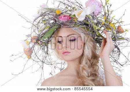 The beautiful girl with wreath from branches