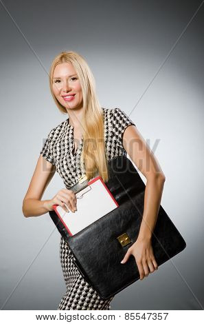 Businesswoman in business concept  with briefcase