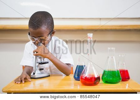 Pupil looking through microscope at the elementary school