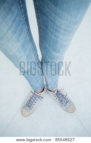 Woman wearing trainers on white background