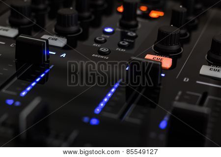DJ mixer in a club, close up.