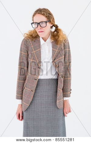 Geeky hipster woman looking nervous on white background