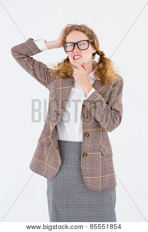 Geeky hipster thinking with hands on chin and temple on white background
