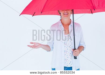 Woman holding an umbrella on white background