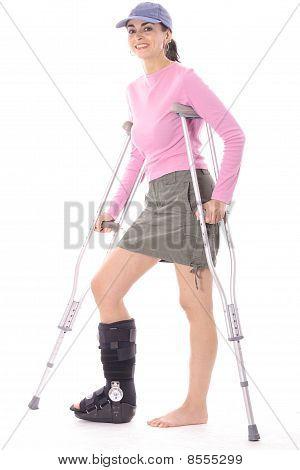 happy woman on crutches