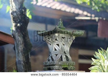 A temple stone column in praying  incense