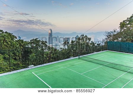 Top Of Skyscraper By Night With Panorama Of Hong Kong And Tennic Courts