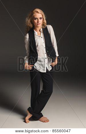 Beauty Blond Woman On A Gray Background