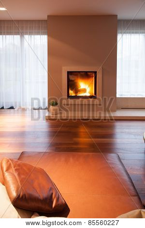 Burning Fireplace In Cozy Interior