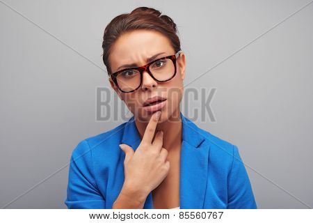 Thoughtful mixed race woman wearing glasses