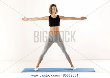 Girl Exercise With Outstretched Arms
