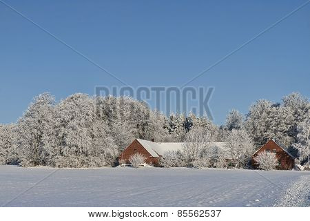 Farmhouse In The Snow