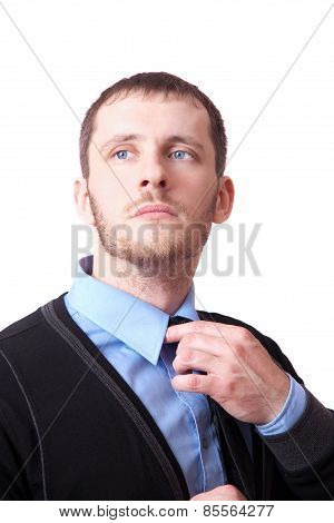 Attractive Business Man Straightens His Tie