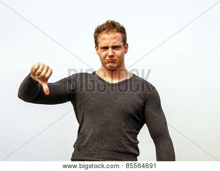 Attractive Young Fashion Man Showing The Thumbs Down Gesture