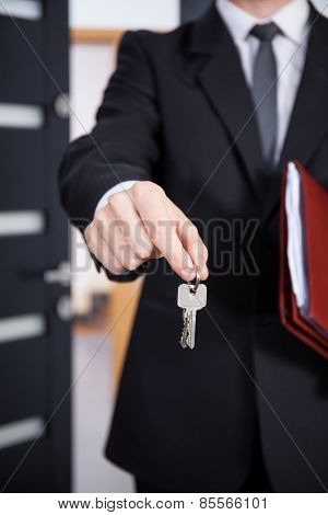 Close-up Of The Keys In The Hands Of Estate Agent