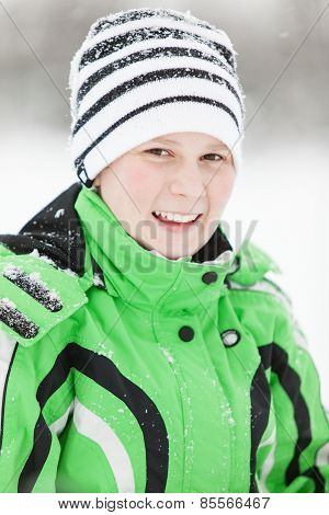 Cold Smiling Young Boy In Winter Clothes