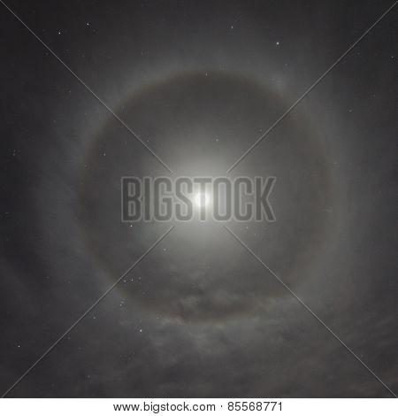 Natural Phenomenon In The Night Sky. Moon Halo