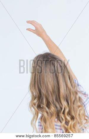 Pretty hipster showing with her hand on white background