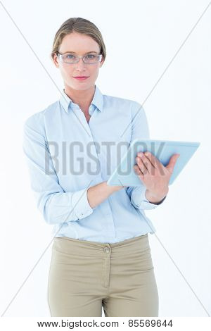 Businesswoman using tablet pc on white background