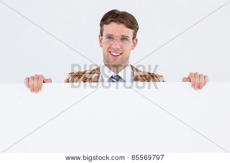 Geeky hipster smiling and showing card on white background