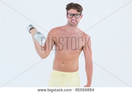 Geeky hipster posing topless with dumbbell on white background