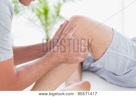 Man having knee massage in medical office
